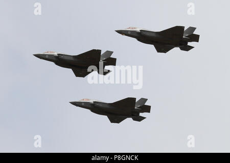 Three of the four current UK based RAF F-35B Lightnings seen during the RAF 100 years anniversary flypast while over Ipswich, Suffolk. - Stock Photo