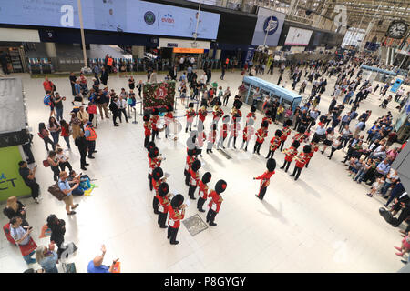 London UK. 11th July 2018. Members of the Coldstream Guards band perform on the concourse to celebrate the 170th anniversary of Waterloo Station London which opened in 1848 Credit: amer ghazzal/Alamy Live News - Stock Photo