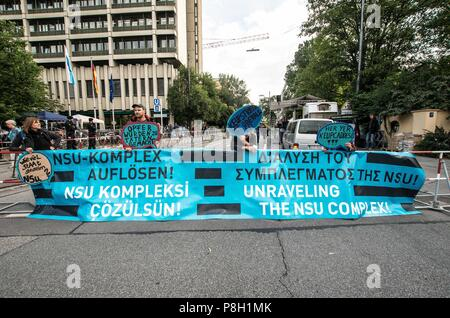 Munich, Bavaria, Germany. 11th July, 2018. ''Dissolve the NSU-Complex, referring to the judicial system and law enforcement claims that the NSU terror cell no longer exists. Critics maintain that most of the members are still at large and that there's a cover up. After five years and some 400 process days, German neo-nazi terrorist Beate Zschape was given a life sentence with a special classification of severe criminality that will make her minimum incarceration 21 years. Credit: ZUMA Press, Inc./Alamy Live News - Stock Photo