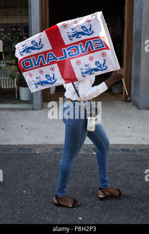 London, UK. 11th July 2018. England fans in east London get ready for tonight's FIFA 2018 World Cup match England vs Croatia. Credit: Guy Corbishley/Alamy Live News - Stock Photo