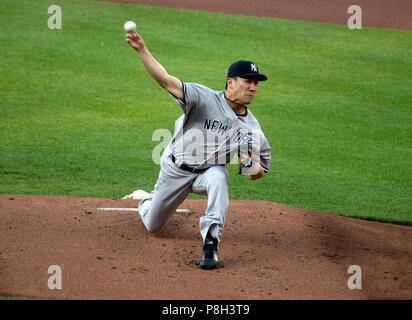 Baltimore, United States Of America. 10th July, 2018. New York Yankees starting pitcher Masahiro Tanaka (19) works in the first inning against the Baltimore Orioles at Oriole Park at Camden Yards in Baltimore, MD on Tuesday, July 10, 2018. Credit: Ron Sachs/CNP (RESTRICTION: NO New York or New Jersey Newspapers or newspapers within a 75 mile radius of New York City) | usage worldwide Credit: dpa/Alamy Live News - Stock Photo