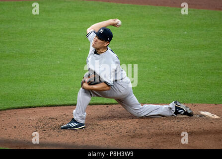 Baltimore, United States Of America. 10th July, 2018. New York Yankees starting pitcher Masahiro Tanaka (19) works in the fourth inning against the Baltimore Orioles at Oriole Park at Camden Yards in Baltimore, MD on Tuesday, July 10, 2018. Credit: Ron Sachs/CNP (RESTRICTION: NO New York or New Jersey Newspapers or newspapers within a 75 mile radius of New York City) | usage worldwide Credit: dpa/Alamy Live News - Stock Photo