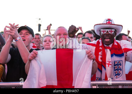 London, UK. 11th July, 2018. 30,000 England fans attend the public screening of the FIFA 2018 World Cup semi-final between England and Croatia in Hyde Park, the largest such screening of a football match since 1996. The event was organised by the Mayor of London and Government in conjunction with the Royal Parks, the Football Association and other agencies. The match provides England with the chance to reach their first World Cup final since 1966. Credit: Mark Kerrison/Alamy Live News - Stock Photo