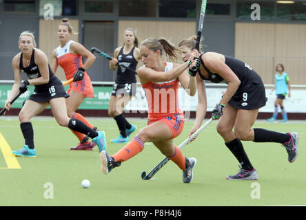 Gruenwald Near Munich, Germany. 11th July, 2018. from left in front KELLY JONKER (Netherlands) shoots as BROOK NEAL (New Zealand) defends, women's hockey, real Four Nations Cup 2018.New Zealand defeats Netherlands 3-1 at leisure park Gruenwald. Credit: Wolfgang Fehrmann/ZUMA Wire/Alamy Live News - Stock Photo