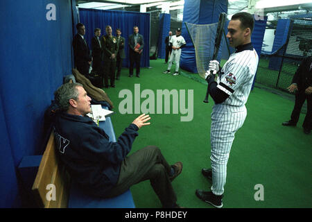 911 President George W. President George W. Bush talks with Yankee shortstop Derek Jeter Tuesday, Oct. 30, 2001, before throwing out the ceremonial first pitch in Game Three of the World Series between the Arizona Diamondbacks and the New York Yankees at Yankee Stadium in New York. - Stock Photo