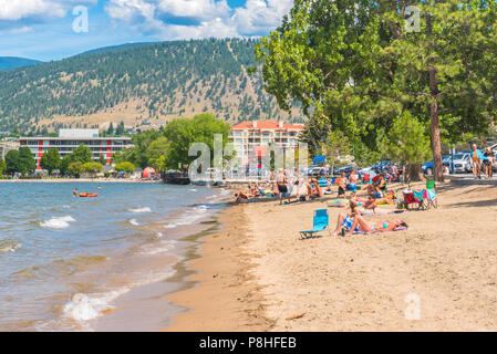 Penticton, British Columbia/Canada - July 7, 2018:  tourists and locals relax and enjoy Okanagan beach in downtown Penticton on a hot summer afternoon - Stock Photo