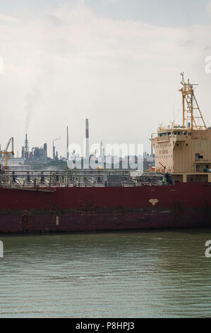 Hafnia Robson oil / chemical tanker docked in front of Fawley oil refinery - Stock Photo