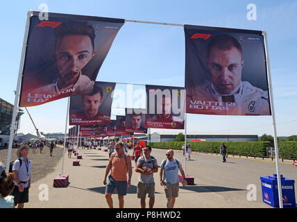 F1 driver images on flags, Silverstone circuit, Northampton, British Grand Prix 2018, England, UK - Stock Photo