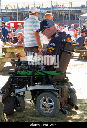 Disabled spectator, at the British Grand Prix, Silverstone Circuit, Towcester, Northamptonshire, England, UK - Stock Photo