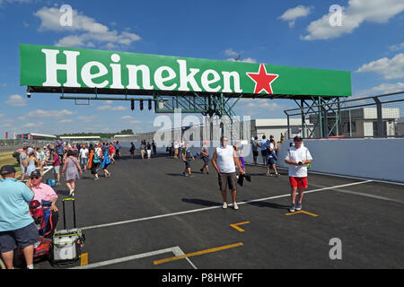Heineken Lager Beer advertising at The British Grand Prix, trackside, Silverstone, Silverstone Circuit, Towcester, Northampton, England, UK,  NN12 8TL - Stock Photo