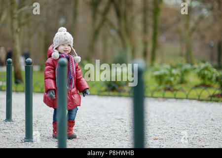 Adorable girl in a park on early spring or late autumn - Stock Photo