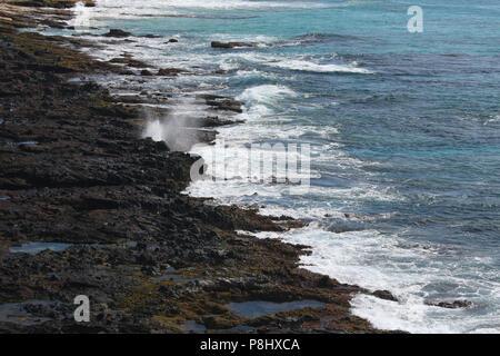 Volcanic rock shoreline as viewed from the Halona Hole Lookout. Oahu Island, Hawaii, USA. - Stock Photo