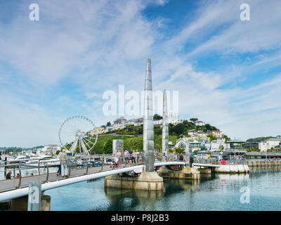 21 May 2018: Torquay, Devon, UK - The Millennium footbridge and the English Riviera Wheel. - Stock Photo