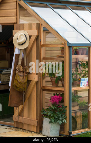 Timber greenhouse & potting shed, on display & for sale on Gabriel Ash trade stand  - RHS Chatsworth Flower Show, Derbyshire, England, UK. - Stock Photo