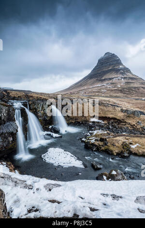 Kirkjufell waterfall in Iceland - Stock Photo