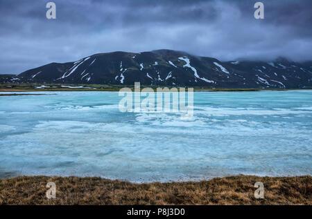 Ice melting in Icelandic wilderness - Stock Photo