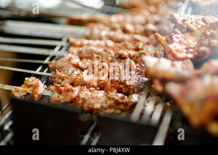 Chicken kabobs grilled on metal skewers - Stock Photo