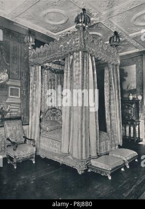 'The King's Bedroom at Knole. With Bedstead Made for James I and Chair and Stools of a Later Period', 1928. From Old Furniture, Volume III., edited by - Stock Photo