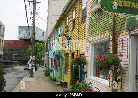 Queen Street in downtown Halifax is an array of brightly painted stores and restaurants, bedecked with flower boxes, offering boutiques and sushi. - Stock Photo