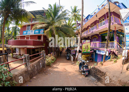 Arambol, Goa, Iindia - March 22, 2017: Street shops of sale of souvenirs and clothes for tourists in the Arambol village - Stock Photo
