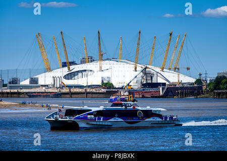 A Thames Clipper On The River Thames With The O2 Arena In The Backround, London, England - Stock Photo