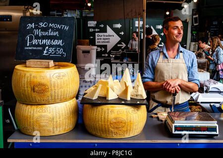 A Man Selling Cheese At A Cheese Stall In Borough Market, London, England - Stock Photo