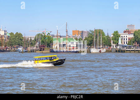 Water taxi on Nieuwe Maas, in Rotterdam, South Holland, The Netherlands - Stock Photo