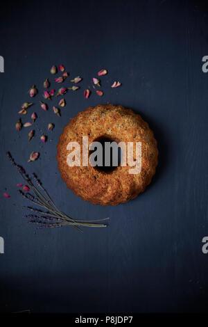 Cinnamon round cake on black background - Stock Photo