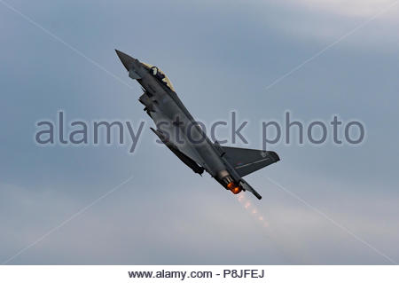 An image of a RAF Typhoon Euro Fighter taking off, full afterburners, vertical - Stock Photo