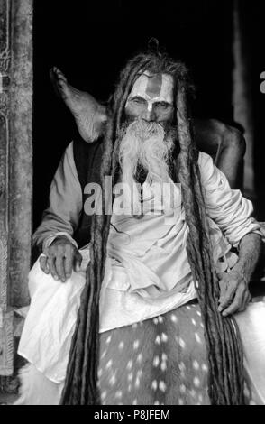 An 84 year old VAISHNAVA SADHU, Vishnu following Hindu Renunciate, does YOGA at PASHUPATINATH - Stock Photo