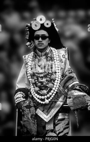 Male Khampa wears tiger skin, coral, zee stones & gold gau boxes at the Litang Horse Festival - Sichuan Province, China, (Tibet) - Stock Photo