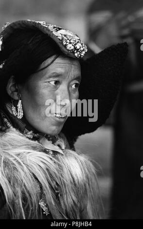 LADAKHI WOMAN showing familial wealth via her PERAK, traditional head piece of silver, coral and TURQUOISE - LADAKH, INDIA - Stock Photo