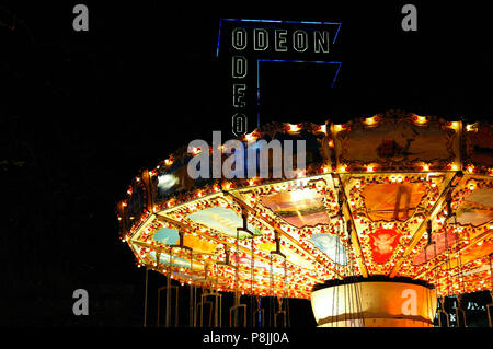 Christmas winter Funfair with chain carousel in Leicester Square, London, England, UK - Stock Photo