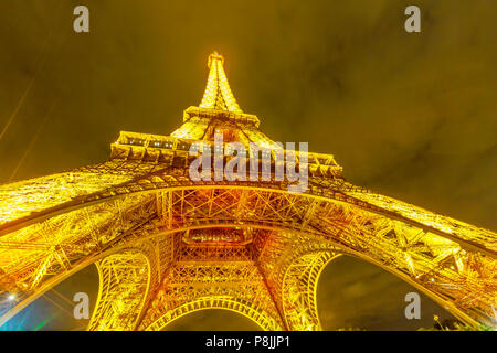 Paris, France - June 30, 2017: wide angle view of Tour Eiffel, symbol and icon of Paris. lower panorama from bottom in Champ de Mars garden in Paris, France. Cityscape by night. - Stock Photo