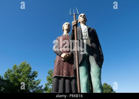 Seward Johnson's 25 foot statue 'God Bless America' in Elkhart Indiana's Central Park is a 3-dimensional re-creation of the iconic painting 'American  - Stock Photo