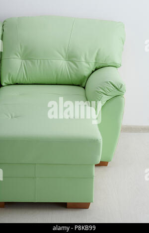 Light leather sofa isolated against the wall - Stock Photo