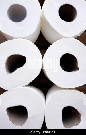 Rolls of soft, white toilet tissue paper (toilet rolls) - Stock Photo