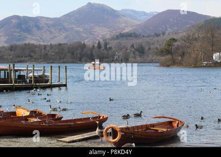 Lady Derwentwater motor launch with Derwent isle in background - Stock Photo