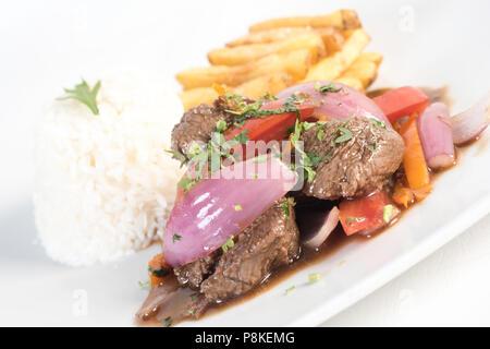 Peruvian dish Lomo saltado. Delicious, typical dish of Peruvian cuisine. - Stock Photo