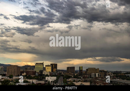 Boise, Idaho, USA. Cityscape with a view along Grove Street of Downtown and a dramatic sunset in summertime. - Stock Photo