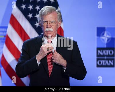 Brussels, Belgium. 12th July, 2018. U.S. National Security Advisor John Bolton attends a press conference by U.S. President Donald Trump on the second day of the NATO Summit in Brussels, Belgium, on July 12, 2018. Credit: Ye Pingfan/Xinhua/Alamy Live News - Stock Photo
