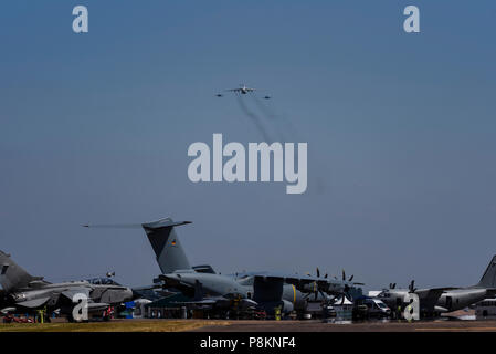 Ukrainian Air Force, an Ilyushin Il-76 tanker transport and two Sukhoi Su-27 Flanker fighters - all Russian built - arriving over RAF Fairford for at Royal International Air Tattoo, RIAT 2018. Transport aircraft below - Stock Photo