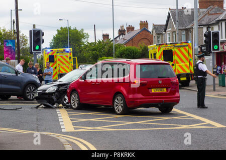 Ballyholme, Northern Ireland. 12th July 2018. A multi vehicle road traffic accident at Ballyholme in Bangor County Ddown Northern Ireland with two ambulances in attendance. details of any injured persons are not yet available but the image shows extensive damge to vehichles with one having mounted the pavement at the entrance to the Windmill Road Credit: MHarp/Alamy Live News - Stock Photo