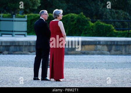 Blenheim Palace, Oxfordshire, UK. 12th July, 2018. Prime Minister Theresa May of the United Kingdom hosts President Donald Trump of the United States of America on Thursday 12 July 2018 at Blenheim Palace, Woodstock. Pictured: Prime Minister, Theresa May with her husband, Philip May, walk out and wait to greet the President. Credit: Julie Edwards/Alamy Live News - Stock Photo