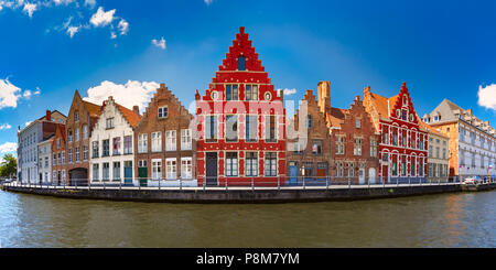 Colorful fun houses on the Bruges canal, Belgium - Stock Photo