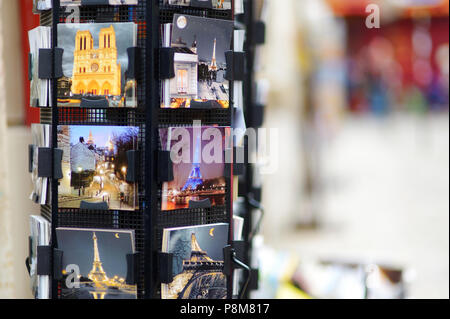 MARCH 1, 2015 - PARIS: Various postcards from Paris displayed at souvenir shop - Stock Photo