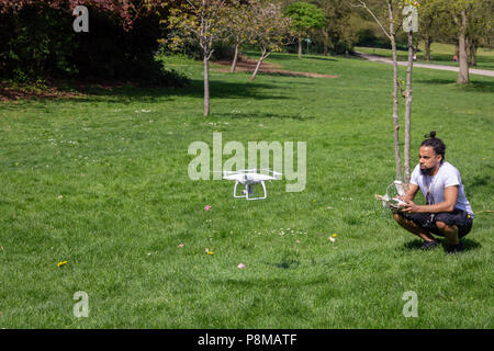 A man flying his drone in a Crystal Palace park, London, England - Stock Photo