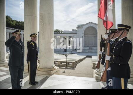 (From left to right) Gen. Joseph K. Aoun, commander, Lebanese Armed Forces, and U.S Army Maj. Gen. John P. Sullivan, assistant deputy chief of staff, G-4, render honors to the Lebanese flag in the Memorial Amphitheater at Arlington National Cemetery, Arlington, Virginia, June 26, 2018, June 26, 2018. Aoun participated in an Armed Forces Full Honors Wreath-Laying Ceremony at the Tomb of the Unknown Soldier and toured the Memorial Amphitheater Display Room as part of his visit to the cemetery. (U.S. Army photo by Elizabeth Fraser / Arlington National Cemetery / released). () - Stock Photo