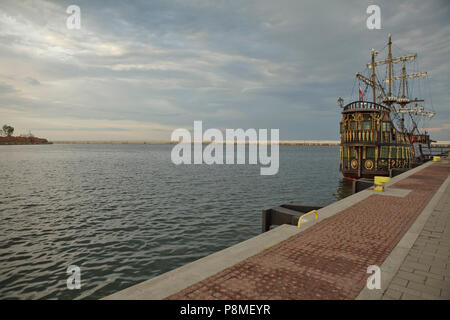ancient ship mooring along the port canal, under cloudy sky, Gdynia, Poland - Stock Photo