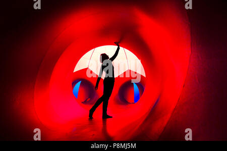 A person explores The Luminarium, a giant interactive art installation, forming part of the Harrogate International Festivals in Yorkshire.